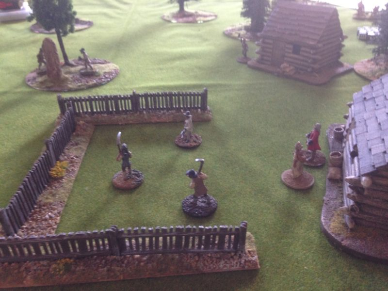 All is peaceful as the villagers tend to their farm, unaware of the Indians sneaking up!