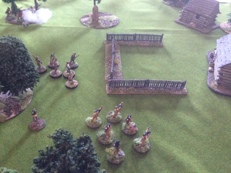 The Indians race towards the houses ready to loot and burn!