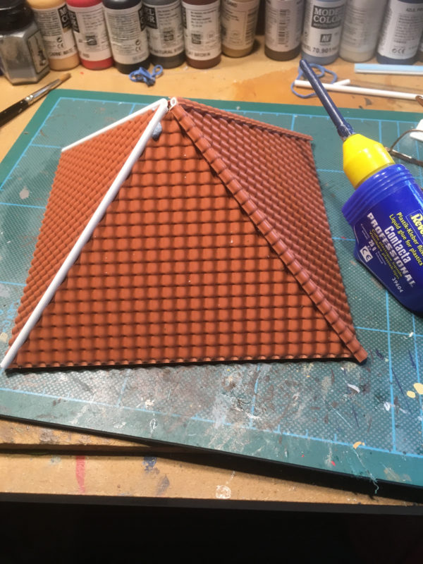 Tile sheets glued to the roof.
