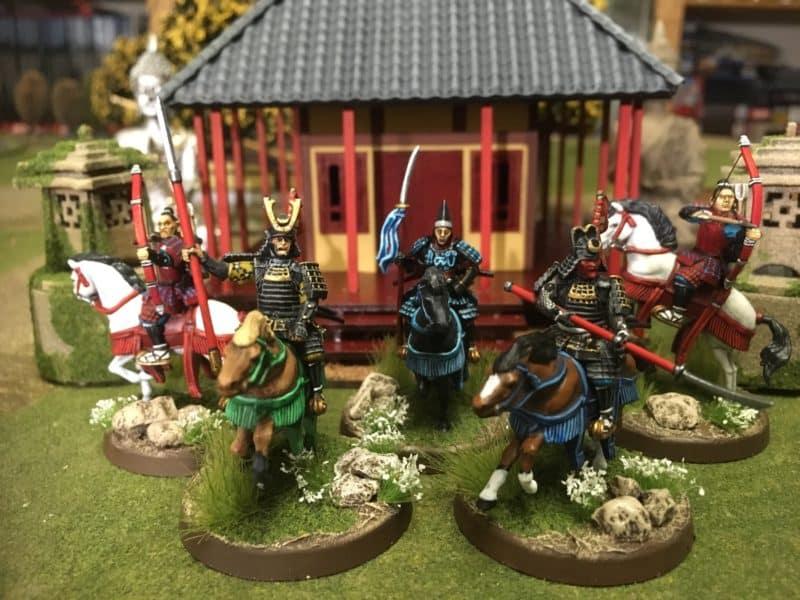 Five mounted samurai in the band.