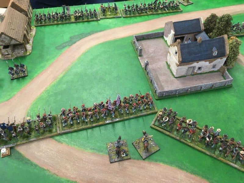 Confederates advance on the farmhouse