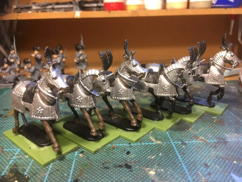 Starting to paint the horses.