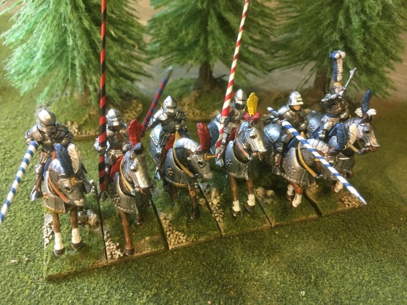 Six Mounted men at arms -the rules set the we use has units of 8 cavalry.
