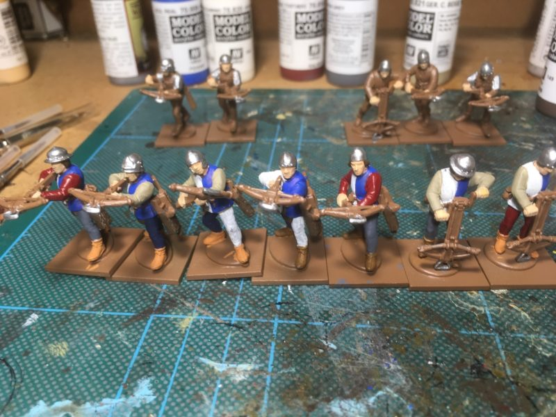 Clothing on Crossbow men block painted.