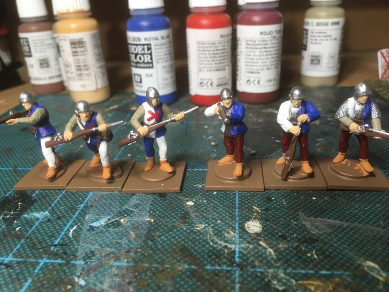 Hand gunners being bath painted.