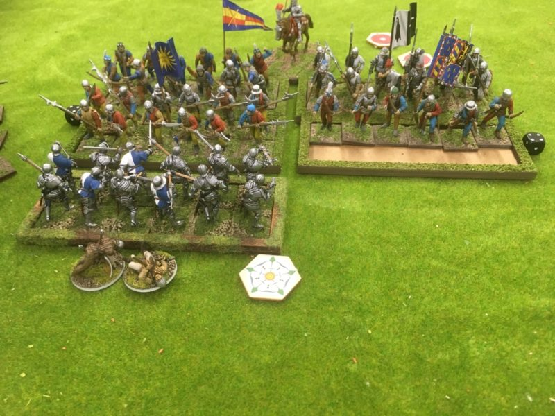 Take two! Men at Arms charge home - this time disarrayed by the hidden terrain.