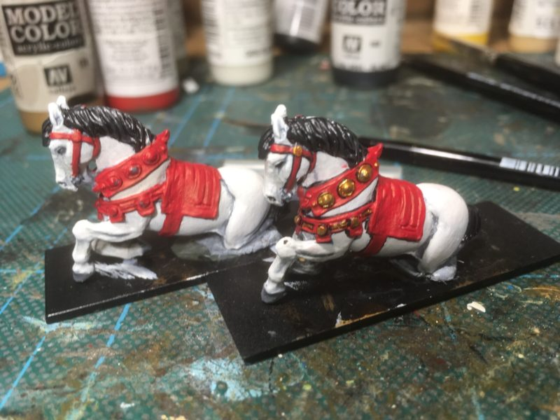 The horses being painted