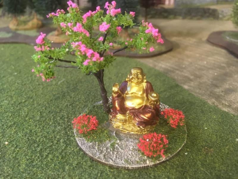 Happy Buddha and blossom tree.